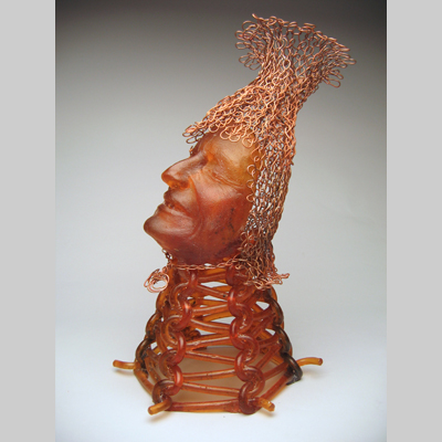 "Knit Wit by Carol Milne - Self-portrait in knitted glass and knitted copper. 19"" x 10"" x 12"""